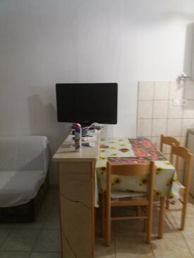 Povlja, Jídelna v ubytování typu studio-apartment, s klimatizací a WiFi.