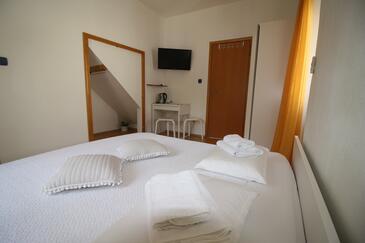 Sumartin, Ložnice v ubytování typu room, s klimatizací a WiFi.