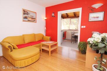 Postira, Obývací pokoj 1 v ubytování typu house, s klimatizací, domácí mazlíčci povoleni a WiFi.
