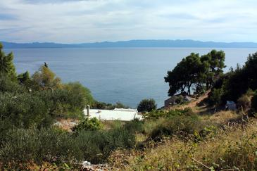 Uvala Vela Lučica, Hvar, Obiekt 5679 - Willa przy morzu ze żwirową plażą.