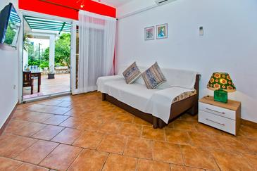 Hvar, Sala de estar in the apartment, air condition available y WiFi.