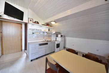 Sukošan, Jedáleň v ubytovacej jednotke apartment, klimatizácia k dispozícii a WiFi.