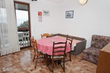 Nemira, Dining room in the apartment, air condition available and WiFi.