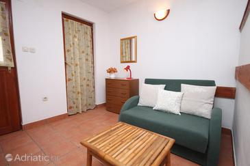 Oštrička luka, Living room in the studio-apartment, air condition available and WiFi.