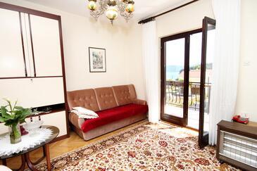 Brgulje, Obývací pokoj v ubytování typu apartment.