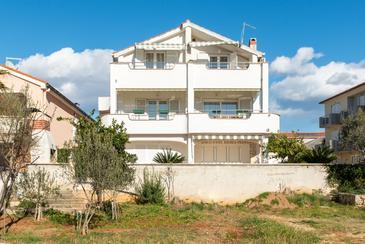 Novalja, Pag, Propiedad 6279 - Apartamentos near sea with pebble beach.