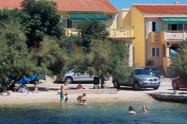 Kustići, Pag, Property 6286 - Apartments near sea with pebble beach.