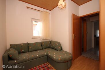 Povljana, Living room in the apartment.