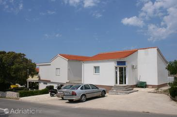 Mandre, Pag, Property 6456 - Apartments with pebble beach.