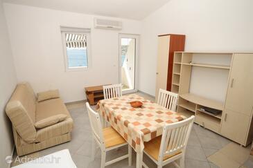 Metajna, Obývacia izba v ubytovacej jednotke apartment, klimatizácia k dispozícii a WiFi.