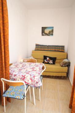 Povljana, Jídelna v ubytování typu apartment, s klimatizací, domácí mazlíčci povoleni a WiFi.