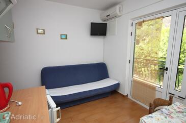 Živogošće - Porat, Living room in the apartment, air condition available and WiFi.