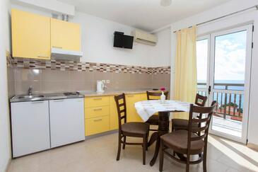 Baška Voda, Столовая в размещении типа apartment, доступный кондиционер и WiFi.