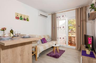 Vela Stiniva, Living room in the apartment, air condition available, (pet friendly) and WiFi.