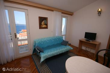 Živogošće - Porat, Living room in the apartment, dostupna klima i WIFI.