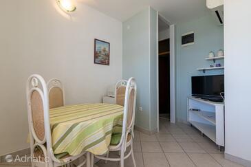 Puntinak, Jídelna v ubytování typu apartment, s klimatizací a WiFi.