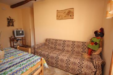 Čepić, Obývací pokoj v ubytování typu house, dopusteni kucni ljubimci i WIFI.