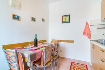 Arbanija, Dining room in the apartment.