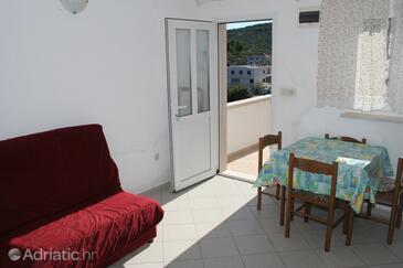 Povlja, Dining room in the apartment, dostupna klima i WIFI.
