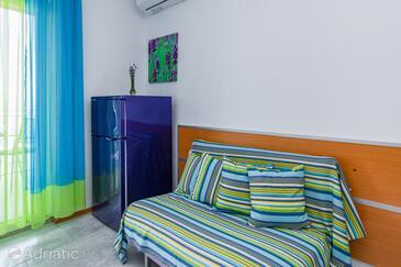 Medveja, Sala de estar in the apartment, air condition available y WiFi.