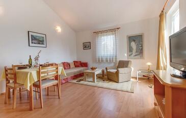 Nerezine, Blagovaonica u smještaju tipa apartment, dostupna klima i WiFi.