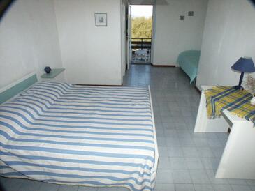 Murter, Sypialnia w zakwaterowaniu typu room, zwierzęta domowe są dozwolone.
