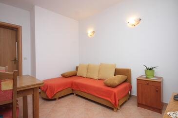 Božava, Dnevni boravak u smještaju tipa apartment, dostupna klima i WiFi.