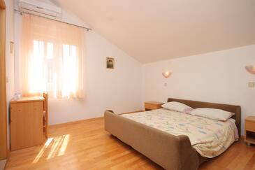Božava, Spavaća soba u smještaju tipa room, dostupna klima i WiFi.