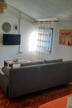Kali, Obývací pokoj v ubytování typu studio-apartment, s klimatizací, domácí mazlíčci povoleni a WiFi.