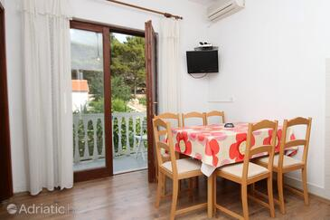 Pašman, Jedáleň v ubytovacej jednotke apartment, klimatizácia k dispozícii a WiFi.