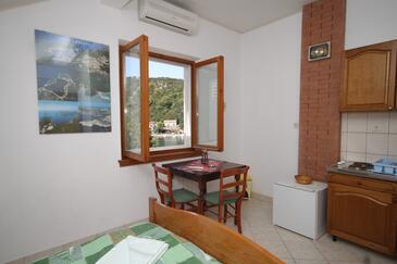 Zaklopatica, Jídelna v ubytování typu studio-apartment, s klimatizací, domácí mazlíčci povoleni a WiFi.