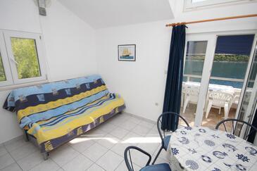 Pasadur, Obývacia izba v ubytovacej jednotke apartment, domáci miláčikovia povolení a WiFi.
