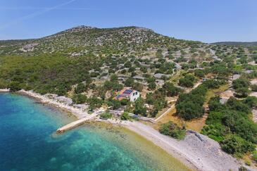 Donje More, Pašman, Объект 8413 - Дом для отдыха вблизи моря с галечным пляжем.