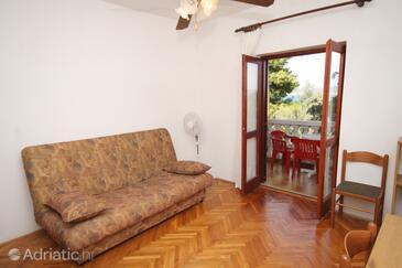 Mrljane, Obývacia izba v ubytovacej jednotke apartment, klimatizácia k dispozícii a WiFi.