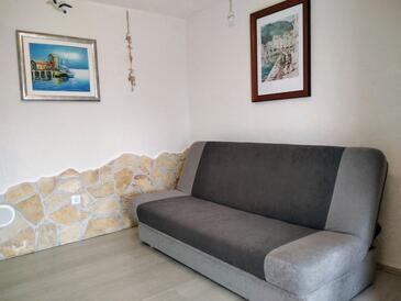 Ugljan, Dnevni boravak u smještaju tipa apartment, dostupna klima i WiFi.