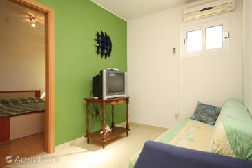 Komiža, Living room in the apartment, air condition available, (pet friendly) and WiFi.