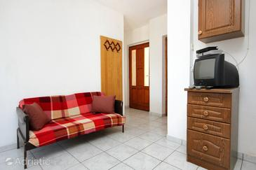 Žman, Living room in the apartment, air condition available and (pet friendly).