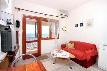 Prižba, Obývací pokoj v ubytování typu apartment, dostupna klima i WIFI.