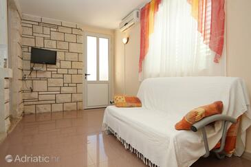 Lumbarda, Living room in the apartment, air condition available and WiFi.