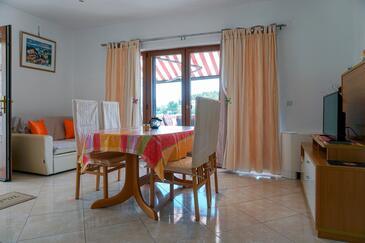 Lumbarda, Jídelna v ubytování typu apartment, s klimatizací a WiFi.