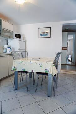 Lumbarda, Jídelna v ubytování typu studio-apartment, s klimatizací a WiFi.