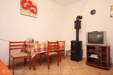 Povljana, Comedor in the apartment, air condition available y WiFi.
