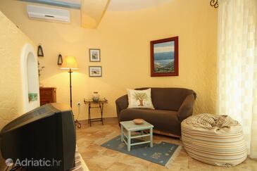 Novalja, Living room in the studio-apartment, dostupna klima, dopusteni kucni ljubimci i WIFI.