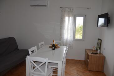 Stara Novalja, Sala da pranzo nell'alloggi del tipo apartment, condizionatore disponibile, animali domestici ammessi e WiFi.