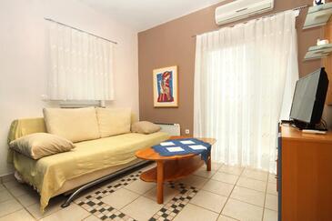 Stara Novalja, Obývací pokoj v ubytování typu apartment, dostupna klima, dopusteni kucni ljubimci i WIFI.
