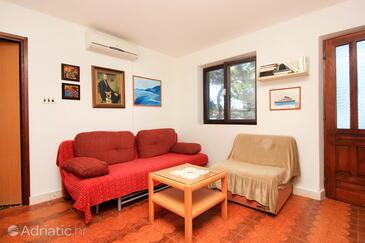 Prižba, Obývací pokoj v ubytování typu house, s klimatizací a domácí mazlíčci povoleni.