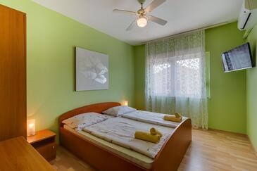 Mali Lošinj, Ložnice v ubytování typu room, s klimatizací a WiFi.
